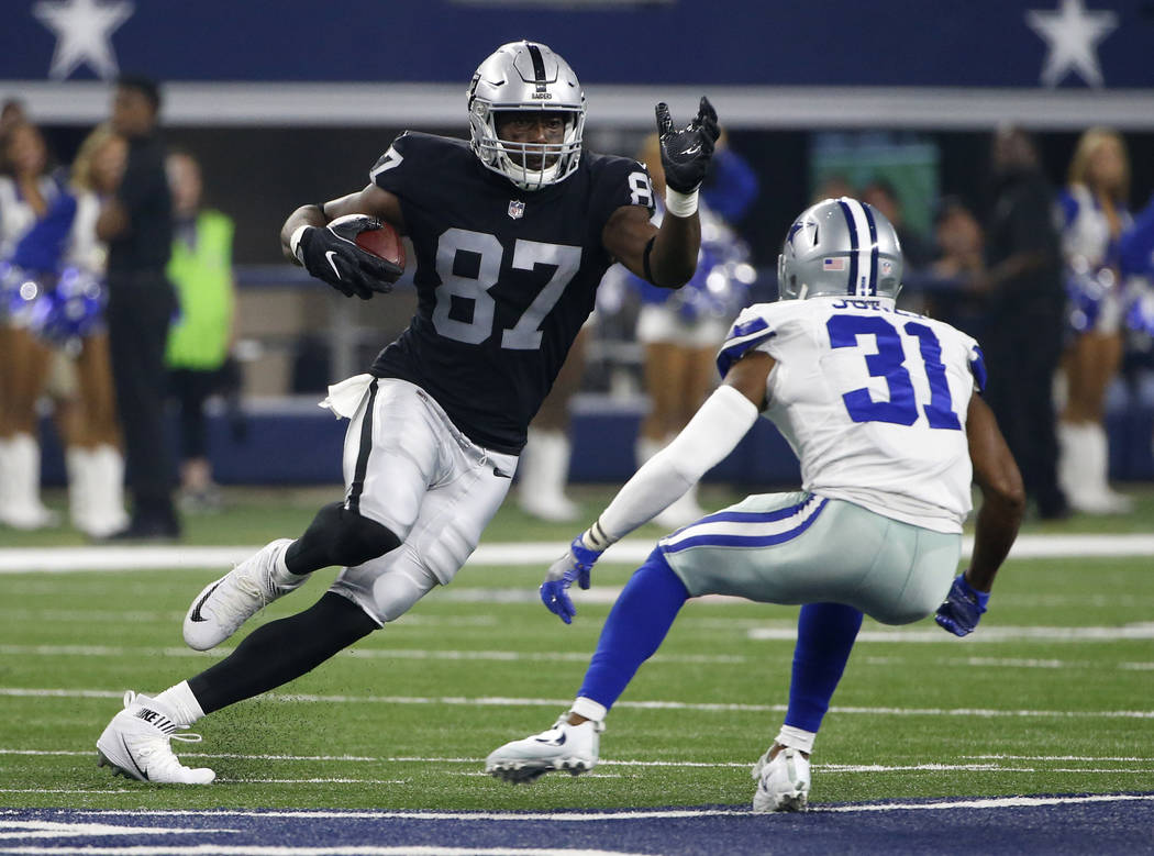 Oakland Raiders tight end Jared Cook (87) looks for running room after catching a pass against Dallas Cowboys safety Byron Jones (31) in the first half of a preseason NFL football game, Saturday,  ...
