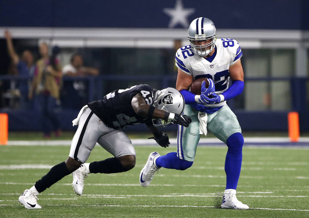 Oakland Raiders safety Karl Joseph (42) attempts to stop Dallas Cowboys tight end Jason Witten (82) as Witten gains yardage after a catch in the first half of a preseason NFL football game, Saturd ...
