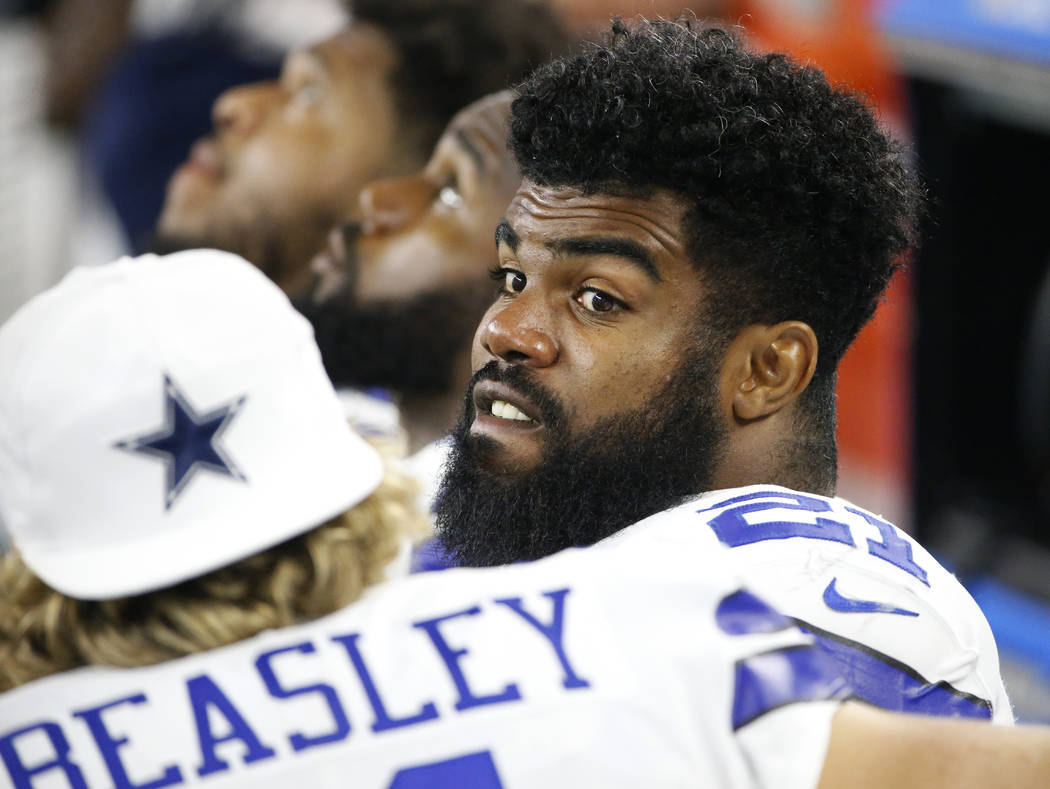 Dallas Cowboys' Cole Beasley (11) talks with running back Ezekiel Elliott, right, on the sideline in the second half of a preseason NFL football game against the Oakland Raiders on Saturday, Aug.  ...