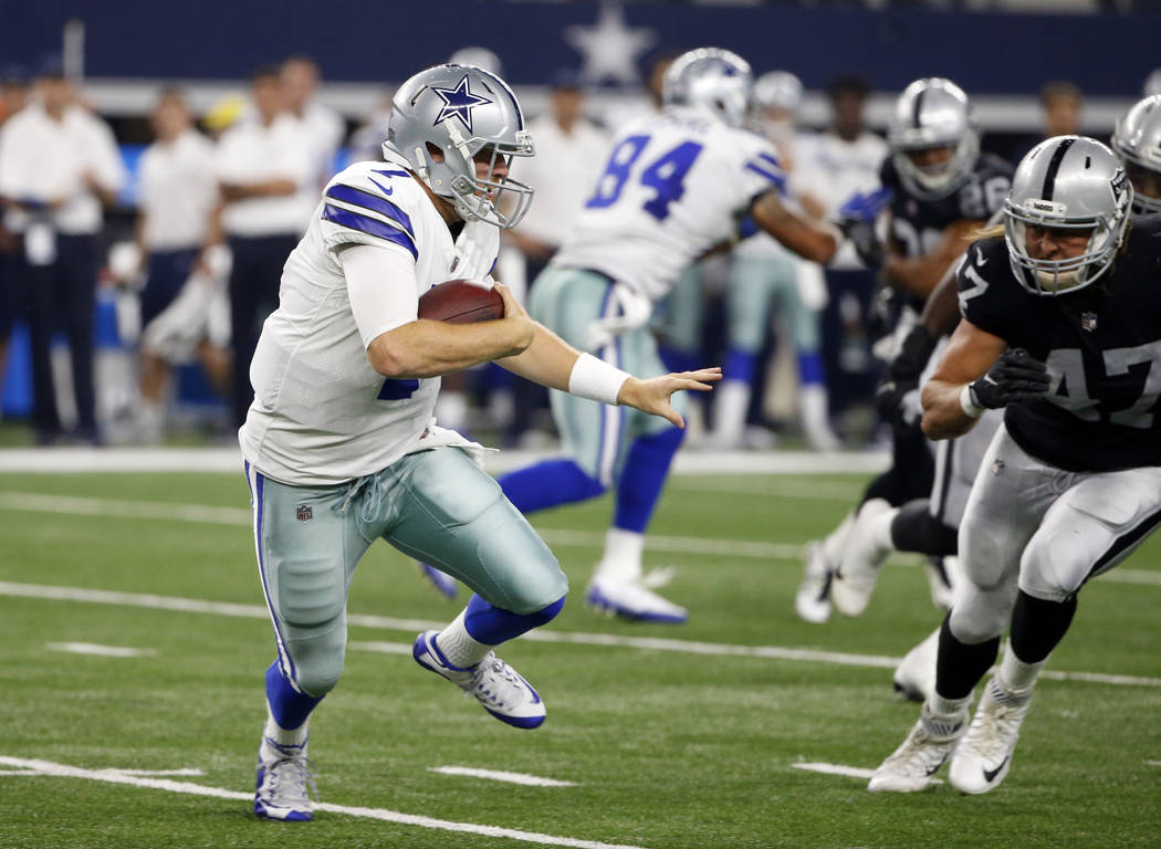 Dallas Cowboys' Cooper Rush runs the ball as Oakland Raiders linebacker James Cowser (47) gives chase in the second half of a preseason NFL football game, Saturday, Aug. 26, 2017, in Arlington, Te ...