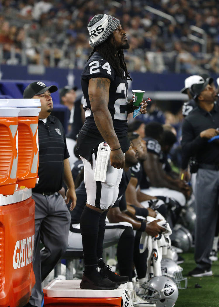 Oakland Raiders running back Marshawn Lynch (24) watches play from the sideline in the second half of a preseason NFL football game against the Dallas Cowboys on Saturday, Aug. 26, 2017, in Arling ...