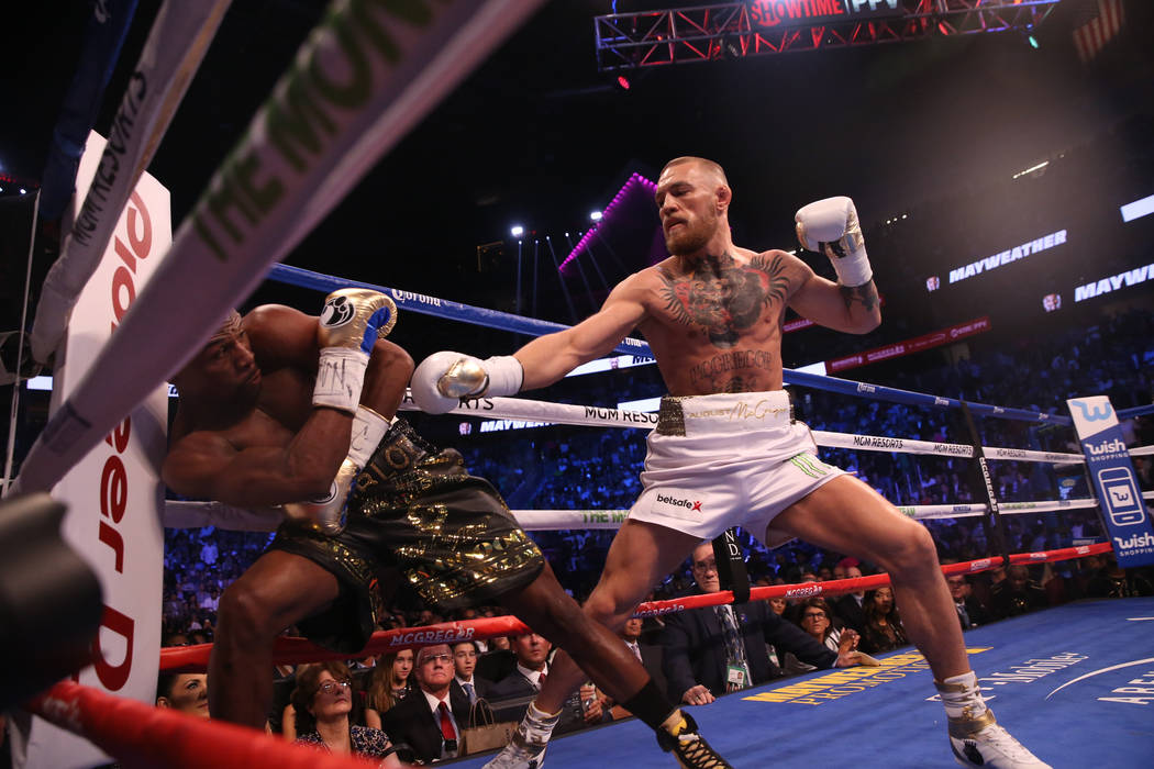 Floyd Mayweather Jr., left, leans to avoid a punch by Conor McGregor during the first round of their fight at T-Mobile Arena, Saturday, Aug. 26, 2017, in Las Vegas. Benjamin Hager Las Vegas Review ...