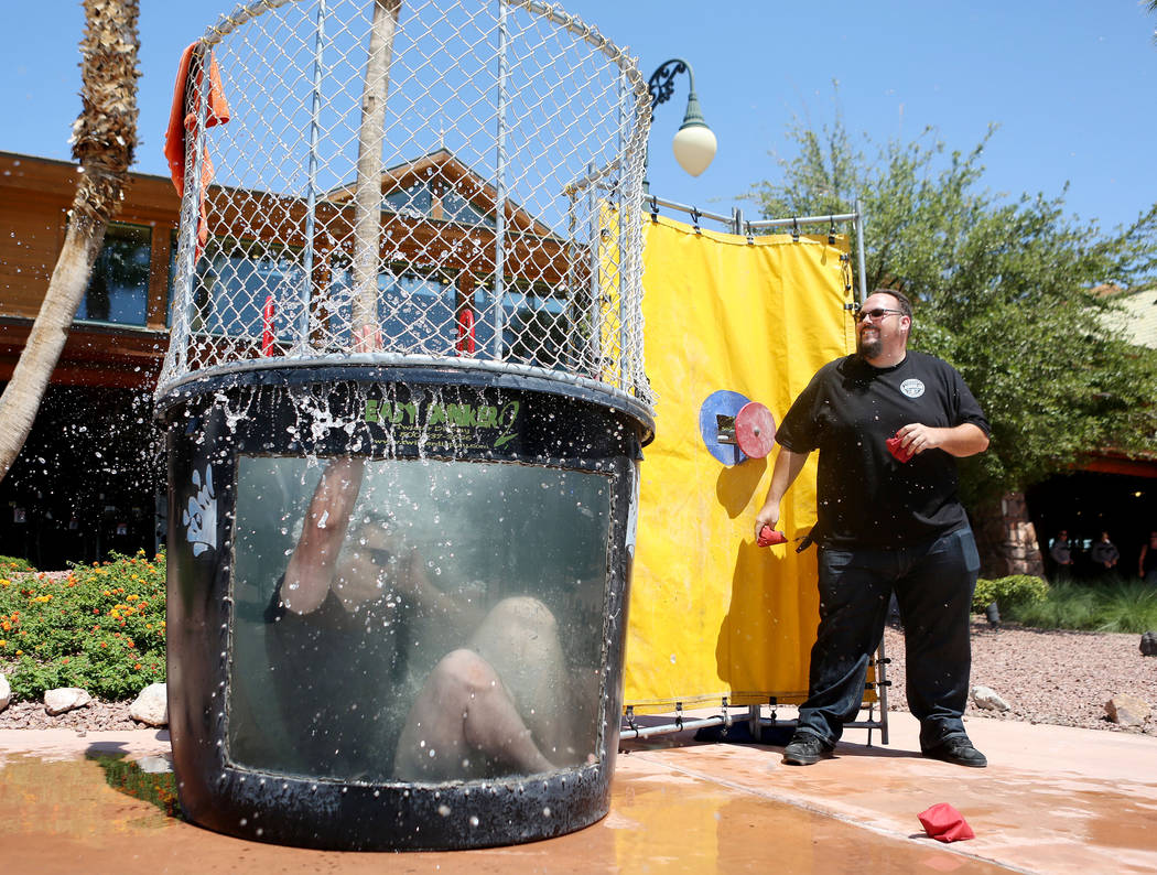 "Nevada Highway Patrol Sgt. Yvan Pittmon in the ""Dunk a Trooper"" tank after Bass Pro Shop customer Carl Keller pushed the button at the parking lot of the Silverton hotel-casino in Las Vegas, Tuesd ..."