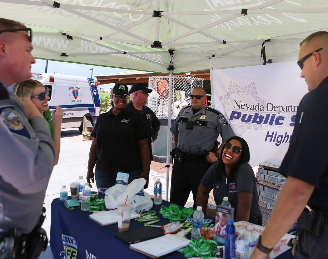 Nevada Donor Network and Nevada Highway Patrol troopers on site of the Bass Pro Shop parking lot of the Silverton hotel- casino to educate the public and assist with becoming a donor, Tuesday, Aug ...