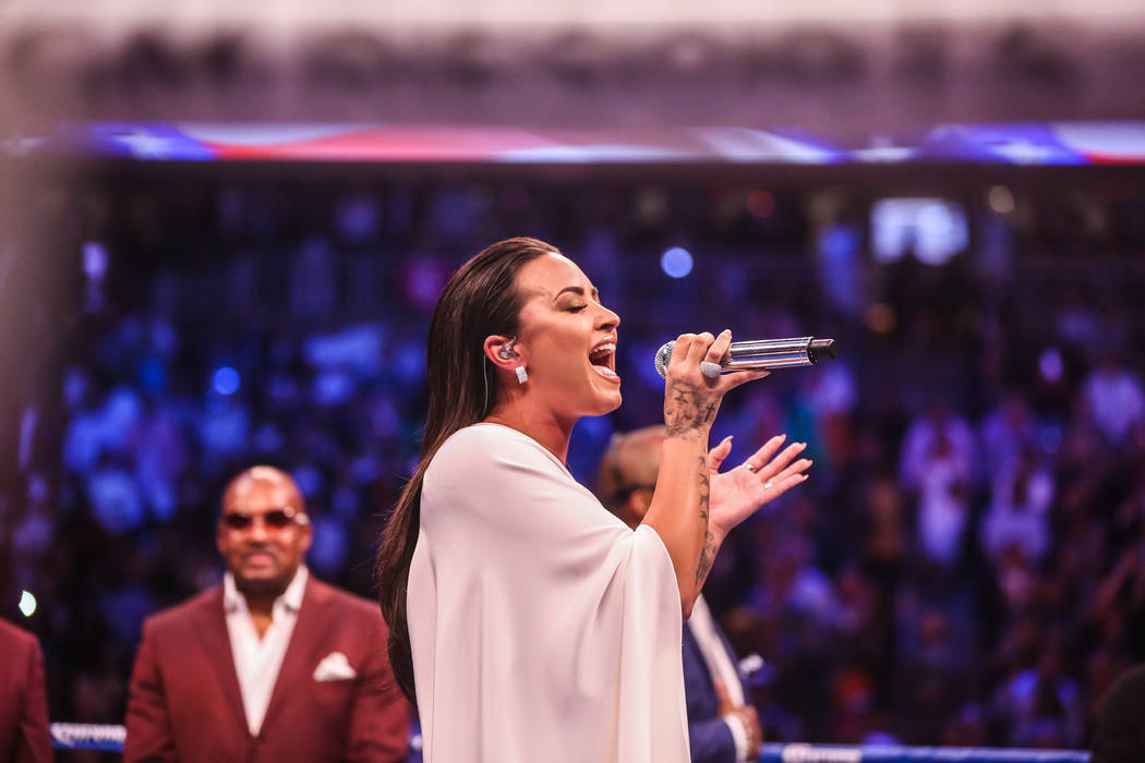Demi Lovato singing the national anthem before Floyd Mayweather Jr. takes on Conor McGregor at T-Mobile Arena, Saturday, Aug. 26, 2017, in Las Vegas. Benjamin Hager Las Vegas Review-Journal