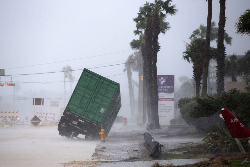 A power generator tips in front of Texas' CHRISTUS Spohn Hospital in Corpus Christi, Texas, as Hurricane Harvey hits Friday, Aug. 25, 2017. (Courtney Sacco/Corpus Christi Caller-Times via AP)