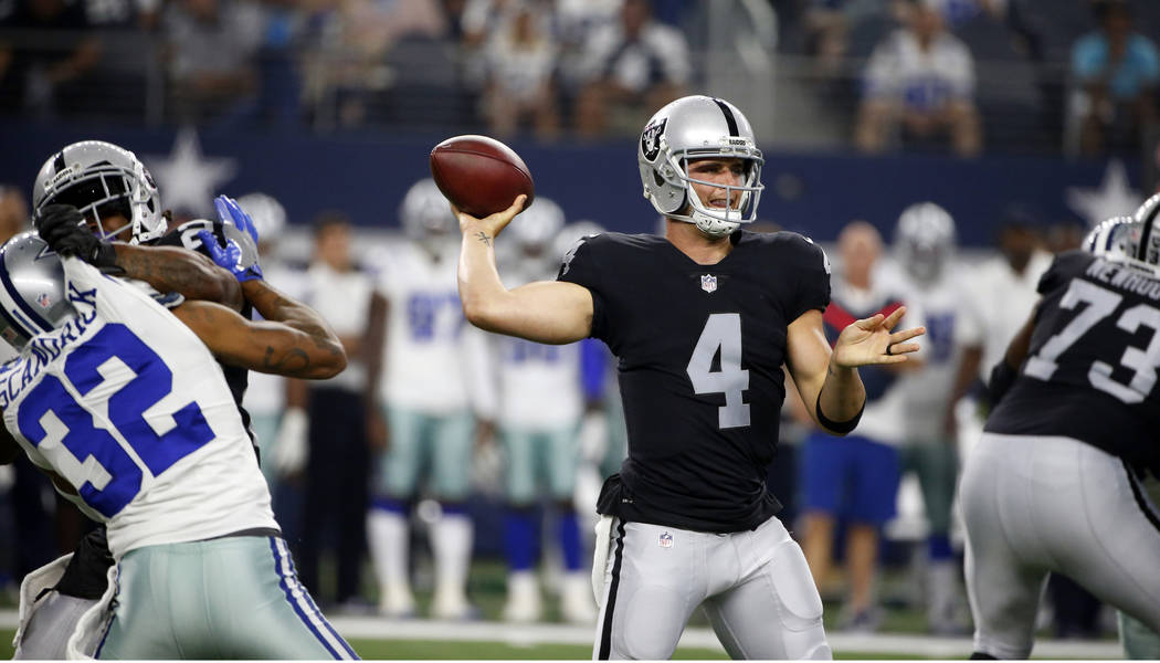 Dallas Cowboys cornerback Orlando Scandrick (32) pressures the pocket as Oakland Raiders quarterback Derek Carr (4) throws a pass in the first half of a preseason NFL football game, Saturday, Aug. ...