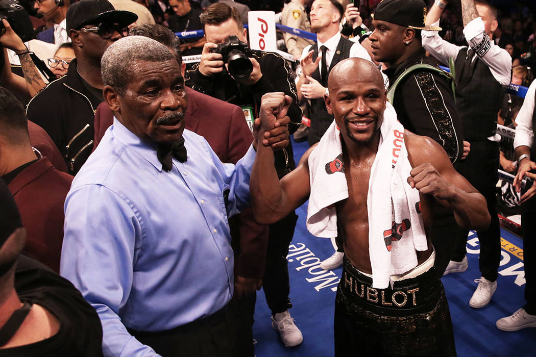 Floyd Mayweather, right, celebrates with referee Robert Byrd after his TKO victory over Conor McGregor on Saturday, Aug 26, 2017, at T-Mobile Arena, in Las Vegas. Benjamin Hager Las Vegas Review-J ...