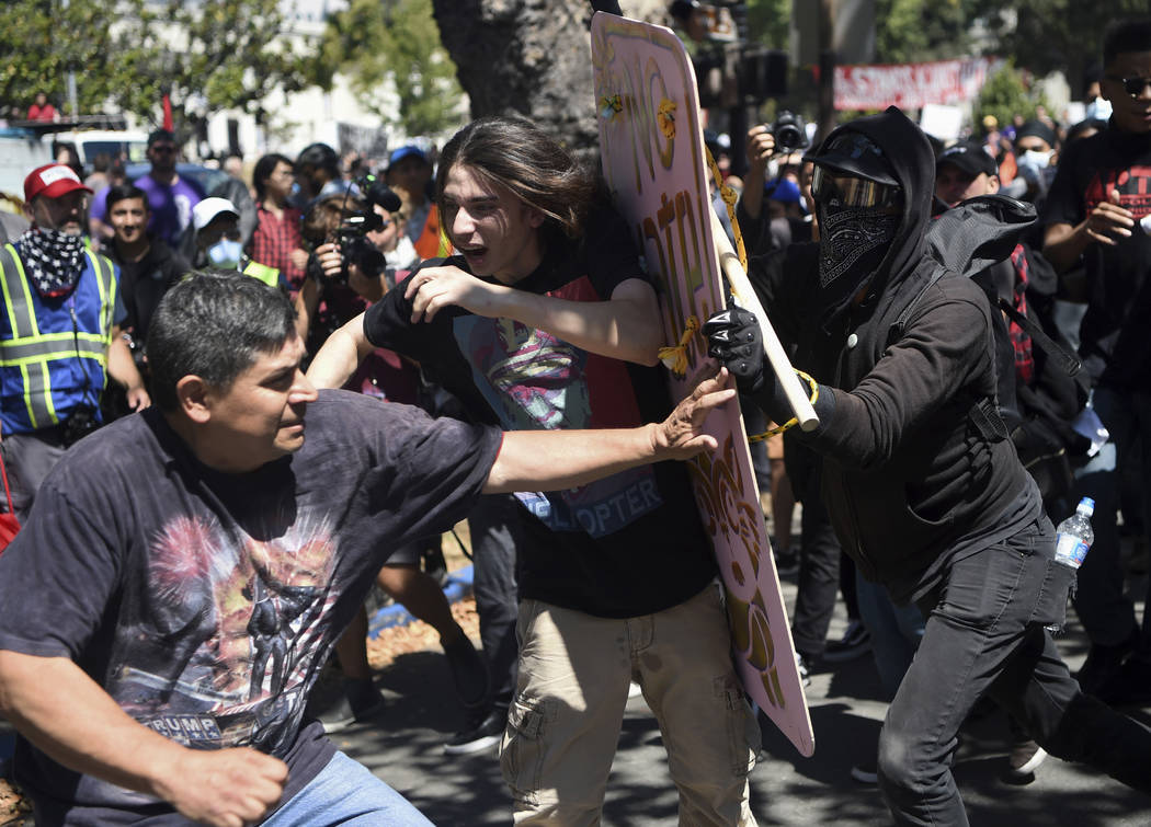 """Demonstrators clash during a free speech rally Sunday, Aug. 27, 2017, in Berkeley, Calif. Several thousand people converged in for a """"Rally Against Hate"""" in response to a planned right-wing protes ..."""