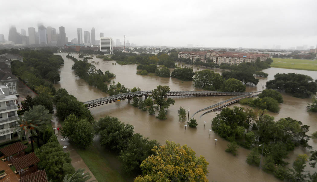 Rain continues to fall in Houston from Tropical Storm Harvey, Monday, Aug. 28, 2017. Floodwaters reached the roof lines of single-story homes Monday and people could be heard pleading for help fro ...