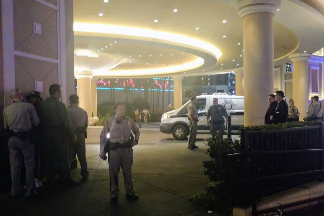 Metro police, left, take a man into custody at The Cromwell on the Las Vegas Strip early Monday morning, Aug. 28, 2017. (Max Michor/Las Vegas Review-Journal)