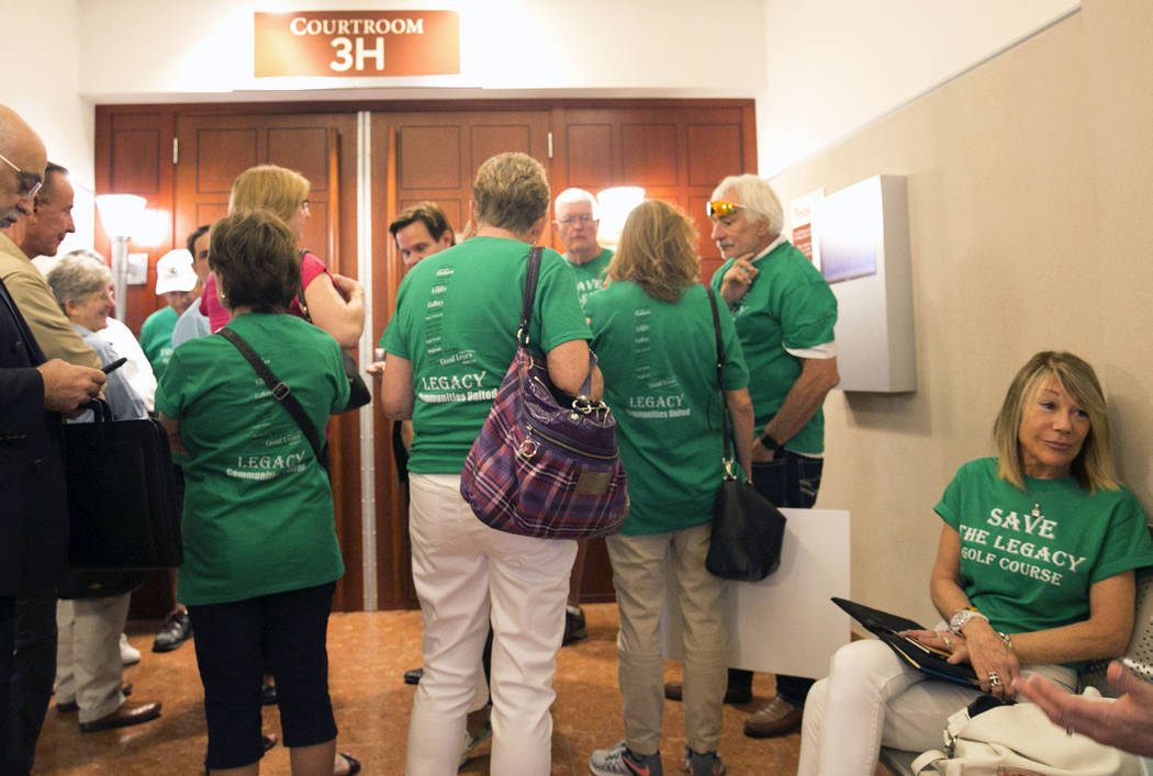 Henderson residents living in homes surrounding the recently purchased Legacy Golf Club wait outside the courtroom at the Regional Justice Center on Tuesday, Aug. 29, 2017, in Las Vegas. (Bizuayeh ...