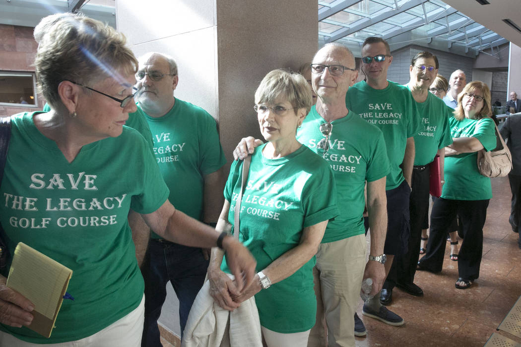 Henderson residents living in homes surrounding the recently purchased Legacy Golf Club, including Ellen Krystal, second left, and her husband, Luis, wait outside the courtroom at the Regional Jus ...