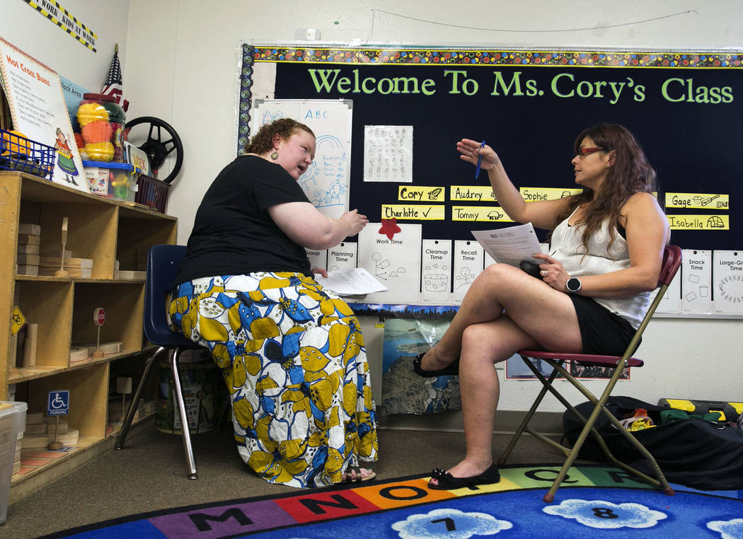 Melissa Richardson, left, master teacher teaching artist from Wolf Trap Institute, and Corrine Rocha, pre-K teacher, discuss on Tuesday, Aug. 29, 2017, inside a classroom at Hill and Dale Preschoo ...