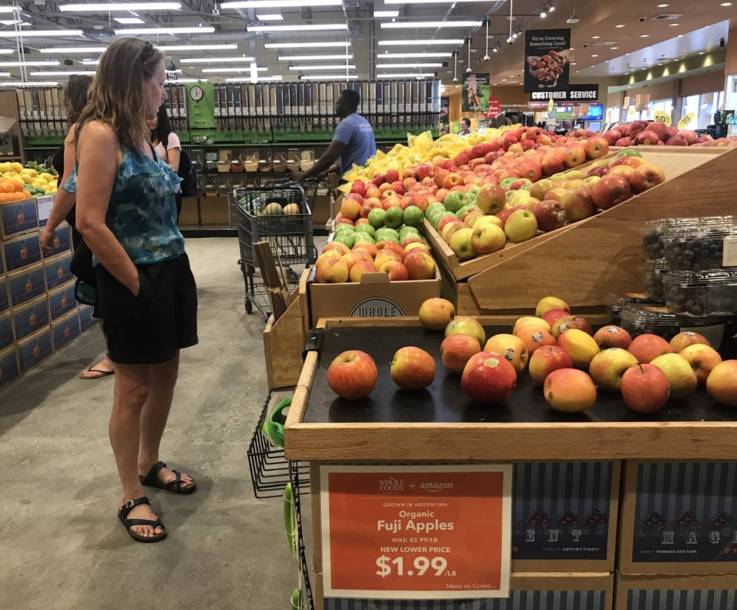 Customers in the produce section at the Summerlin Whole Foods Market on Monday, Aug. 28, 2017, in Las Vegas. Amazon kicked off its first day as the owner of Whole Foods by slashing prices and addi ...