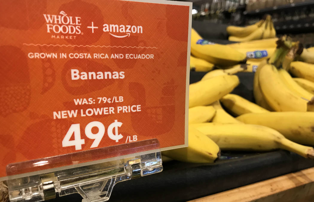 Bananas at the Summerlin Whole Foods Market on Monday, Aug. 28, 2017, in Las Vegas. Amazon kicked off its first day as the owner of Whole Foods by slashing prices and adding its logo on signs. Dav ...