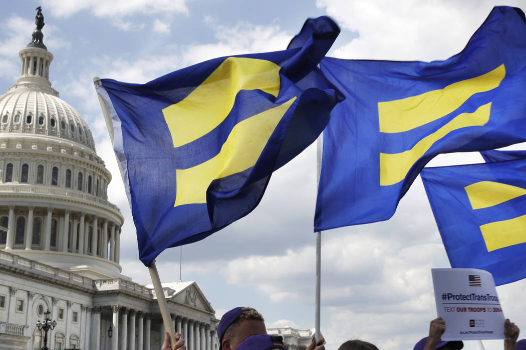 "People with the Human Rights Campaign hold up ""equality flags"" during an event on Capitol Hill in Washington, D.C., July 26, 2017, in support of transgender members of the military. (Jacquelyn Mar ..."