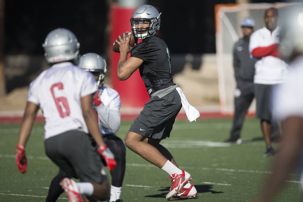 UNLV's quarterback Armani Rogers (1) looks to make a pass during a team practice at Rebel Park in UNLV on Wednesday, March 1, 2017, in Las Vegas. (Erik Verduzco/Las Vegas Review-Journal) @Erik_Ver ...