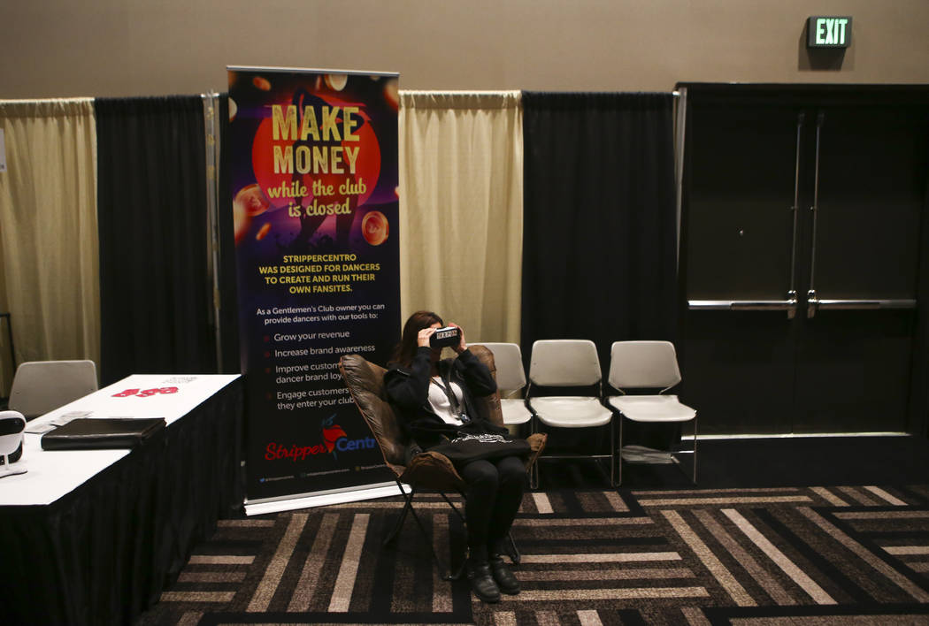 An attendee tests out virtual reality goggles by Terpon during the Gentlemen's Club Expo at Hard Rock Hotel in Las Vegas on Tuesday, Aug. 29, 2017. Chase Stevens Las Vegas Review-Journal @cssteven ...