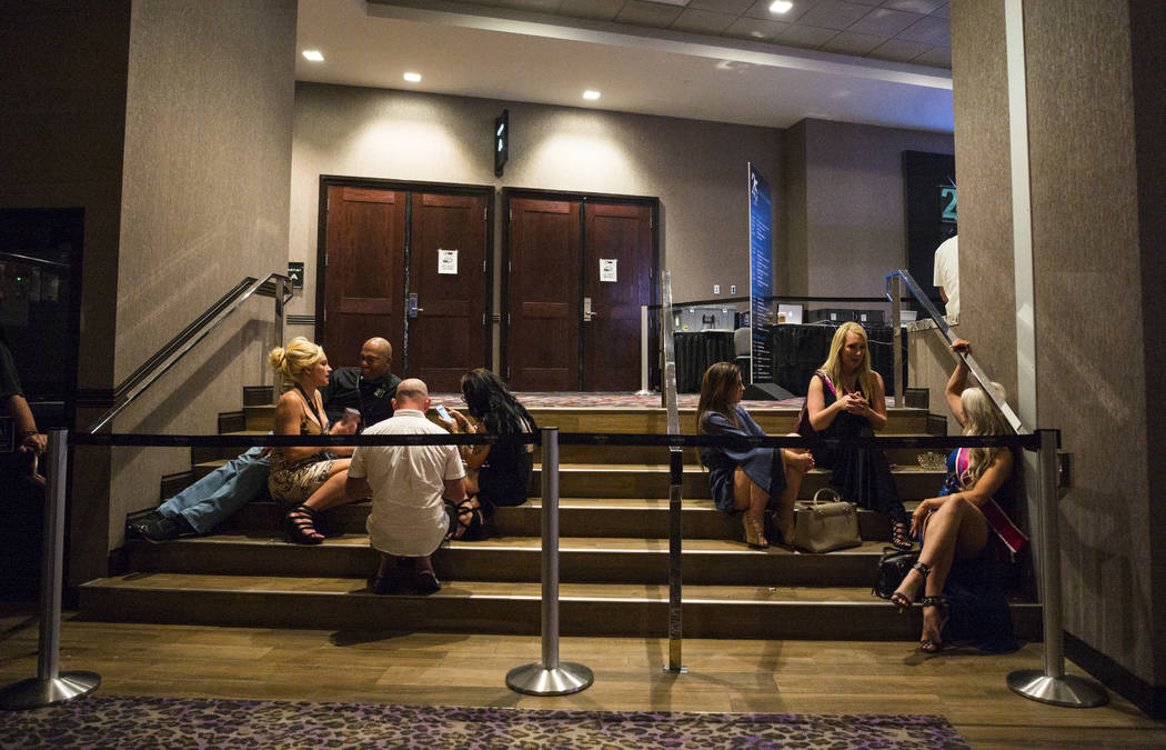 Attendees relax during the Gentlemen's Club Expo at Hard Rock Hotel in Las Vegas on Tuesday, Aug. 29, 2017. Chase Stevens Las Vegas Review-Journal @csstevensphoto