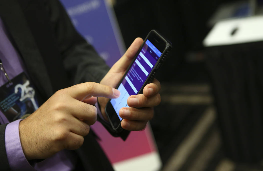 Radu Grama of Frolic shows off the company's app during the Gentlemen's Club Expo at Hard Rock Hotel in Las Vegas on Tuesday, Aug. 29, 2017. Chase Stevens Las Vegas Review-Journal @csstevensphoto