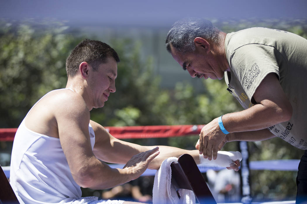 Gennady Golovkin, left, gets his hands wrapped by his trainer Abel Sanchez during a media workout at L.A. Live in Los Angeles, Calif., on Monday, Aug. 28, 2017. Erik Verduzco Las Vegas Review-Jour ...