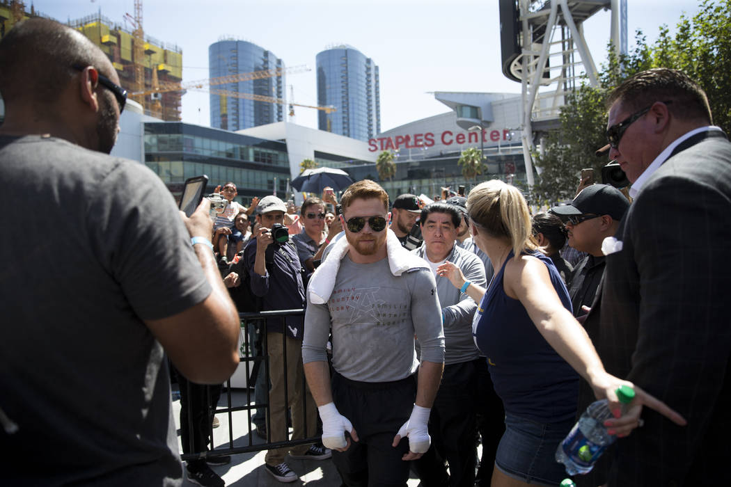 "Saul ""Canelo"" Alvarez walks to the ring during a media workout at L.A. Live in Los Angeles, Calif., on Monday, Aug. 28, 2017. Erik Verduzco Las Vegas Review-Journal @Erik_Verduzco"