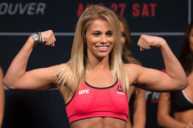 Paige VanZant, of the United States, poses during the weigh-in for a UFC Fight Night event, in Vancouver, British Columbia, on Friday, Aug. 26, 2016. (/Darryl Dyck/The Canadian Press via AP)
