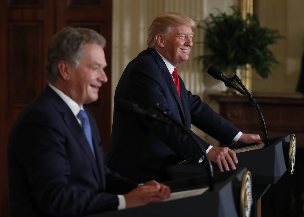 President Donald Trump and Finland President Sauli Niinisto smile in a joint news conference Monday, Aug. 28, 2017, in the East Room of the White House in Washington. (AP Photo/Carolyn K ...