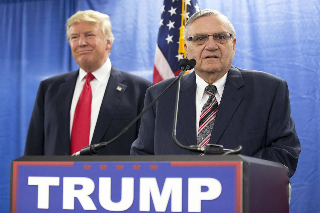 Republican presidential candidate Donald Trump, left, is joined by Maricopa County, Arizona, Sheriff Joe Arpaio during a new conference Jan. 26, 2016, in Marshalltown, Iowa. President Donald Trump ...