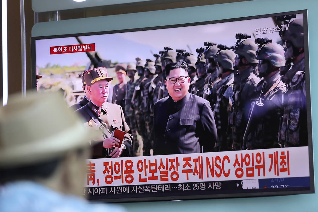 A man watches a screen showing an image of North Korean leader Kim Jong Un, Saturday, Aug. 26, 2017, at the Seoul Train Station in Seoul, South Korea. (Lee Jin-man, File, AP)