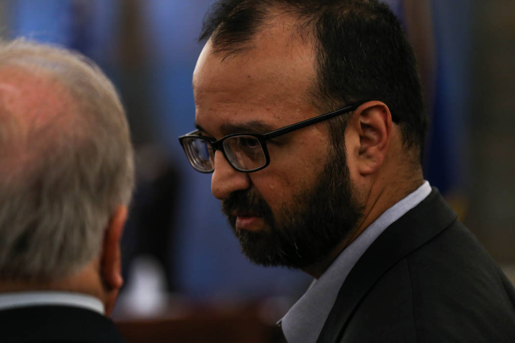 Defense attorney Tom Pitaro, left, speaks to defendant John Valerio, right, in court after being given a verdict of life without parole at the Clark County Regional Justice Center in Las Vegas on  ...