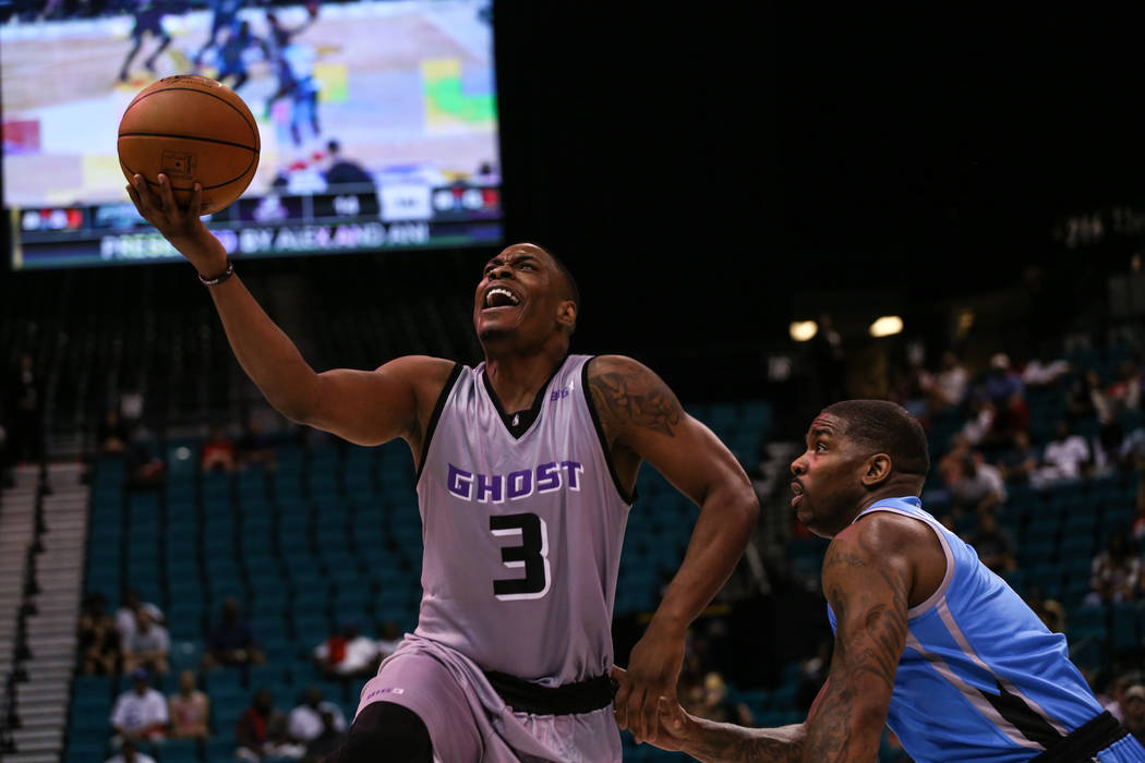 Ghost Ballers' Marcus Banks (3) goes for a lay-up against Powerճ Paul McPherson (6) during the first half of the runner-up game of the Big 3 Championship at the MGM Grand Garden Arena in Las Vega ...