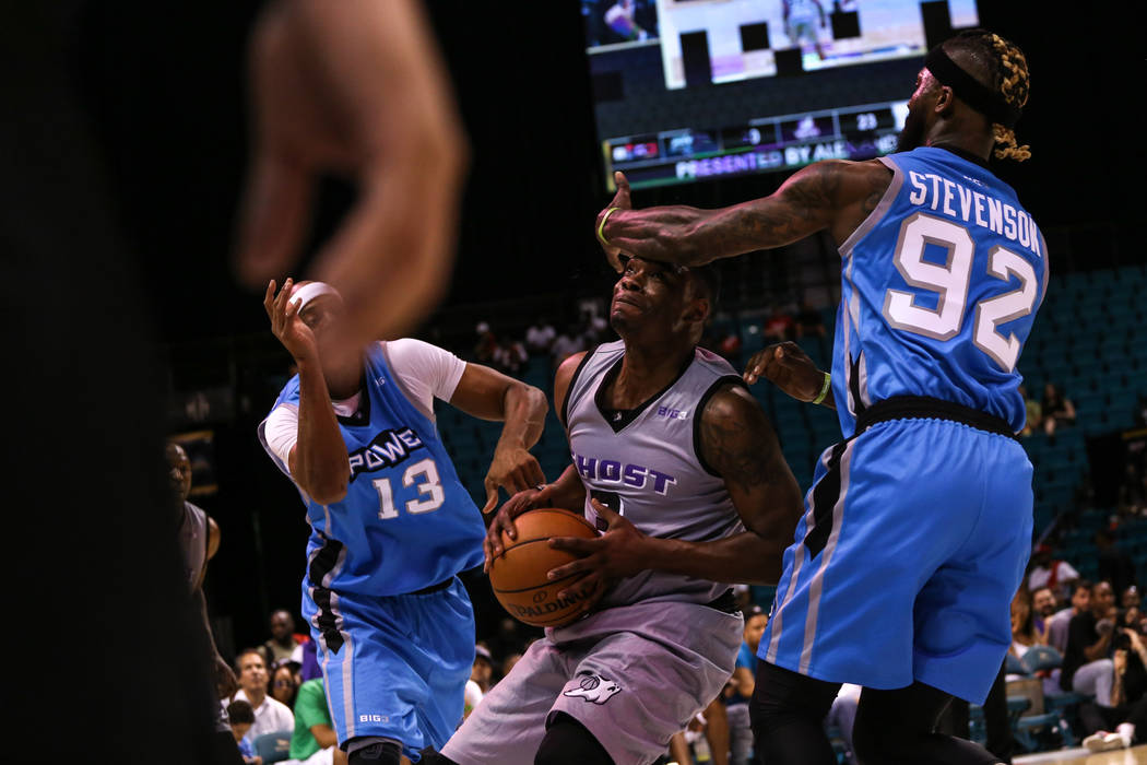 Ghost Ballers' Marcus Banks (3) is guarded by Power's Jerome Williams (13) and DeShawn Stevenson (92) during the first half of the runner-up game of the Big 3 Championship at the MGM Grand Garden  ...