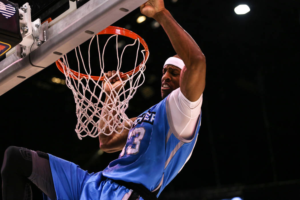 Power's Jerome Williams (13) scores a slam dunk during the second half of the runner-up game of the Big 3 Championship at the MGM Grand Garden Arena in Las Vegas on Aug. 26, 2017. The Ghost Baller ...
