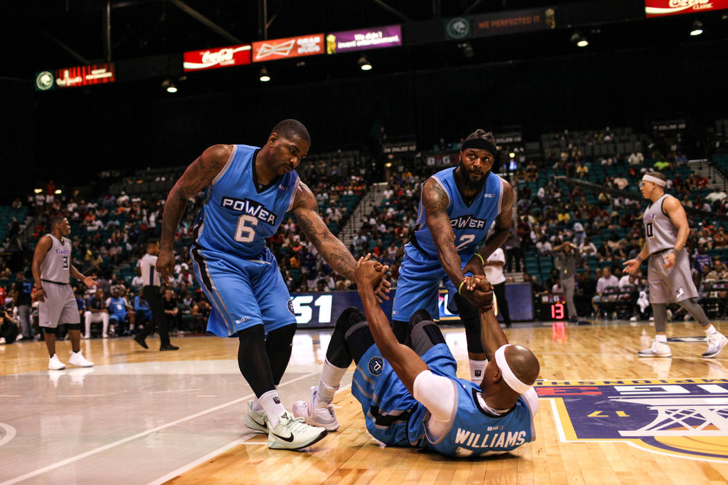 Power's Jerome Williams (13) is helped up by teammates Paul McPherson (6) and DeShawn Stevenson (92) during the second half of the runner-up game of the Big 3 Championship at the MGM Grand Garden  ...