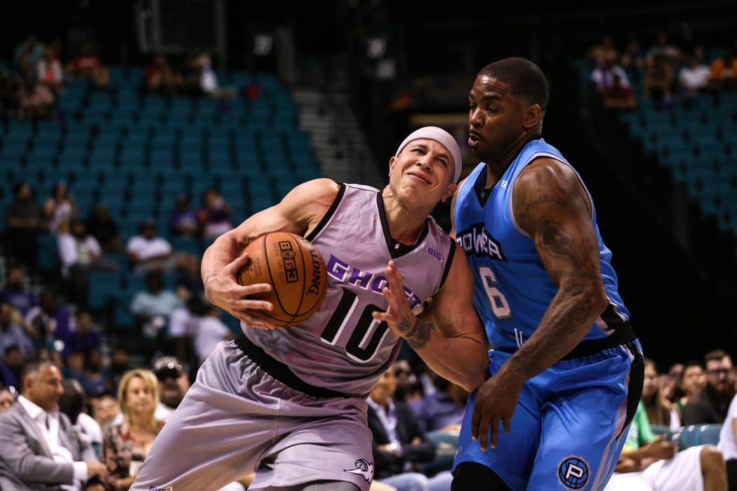 Ghost Ballers' Mike Bobby (10) is guarded by Power's Paul McPherson (6) during the second half of the runner-up game of the Big 3 Championship at the MGM Grand Garden Arena in Las Vegas on Aug. 26 ...