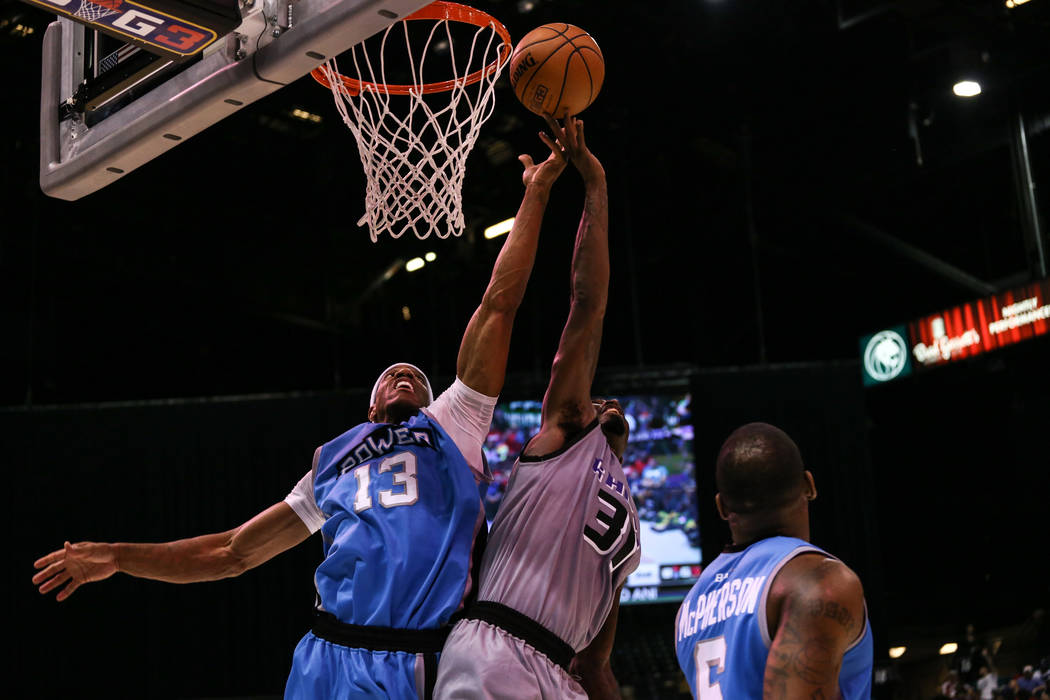 Power's Jerome Williams (13) and Ghost Ballers' Ricky Davis (31) jump for a rebound during the second half of the runner-up game of the Big 3 Championship at the MGM Grand Garden Arena in Las Vega ...