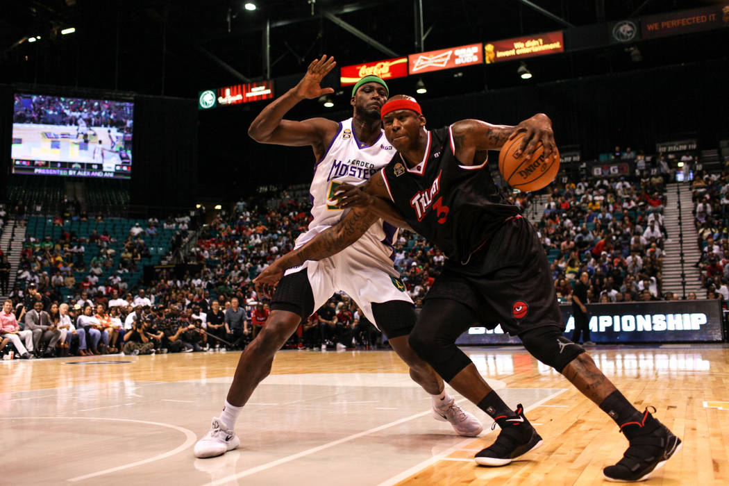 3 Headed Monsters' Kwame Brown (54) guards Trilogy's Al Harrington (3) during the first half of the Big 3 Championship match at the MGM Grand Garden Arena in Las Vegas on Aug. 26, 2017. Trilogy be ...