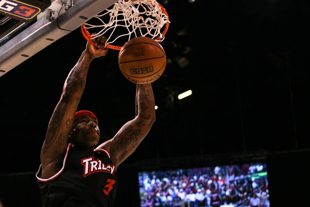 Trilogy's Al Harrington (3) scores a slam dunk during the first half of the Big 3 Championship match at the MGM Grand Garden Arena in Las Vegas on Aug. 26, 2017. Trilogy beat the 3 Headed Monsters ...