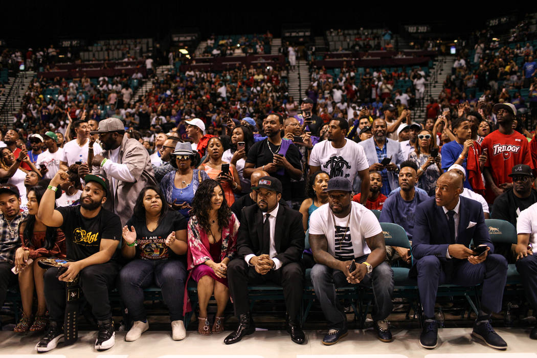 Ice Cube, center, and 50 Cent, second from right, courtside during halftime of the Big 3 Championship match at the MGM Grand Garden Arena in Las Vegas on Aug. 26, 2017. Trilogy beat the 3 Headed M ...