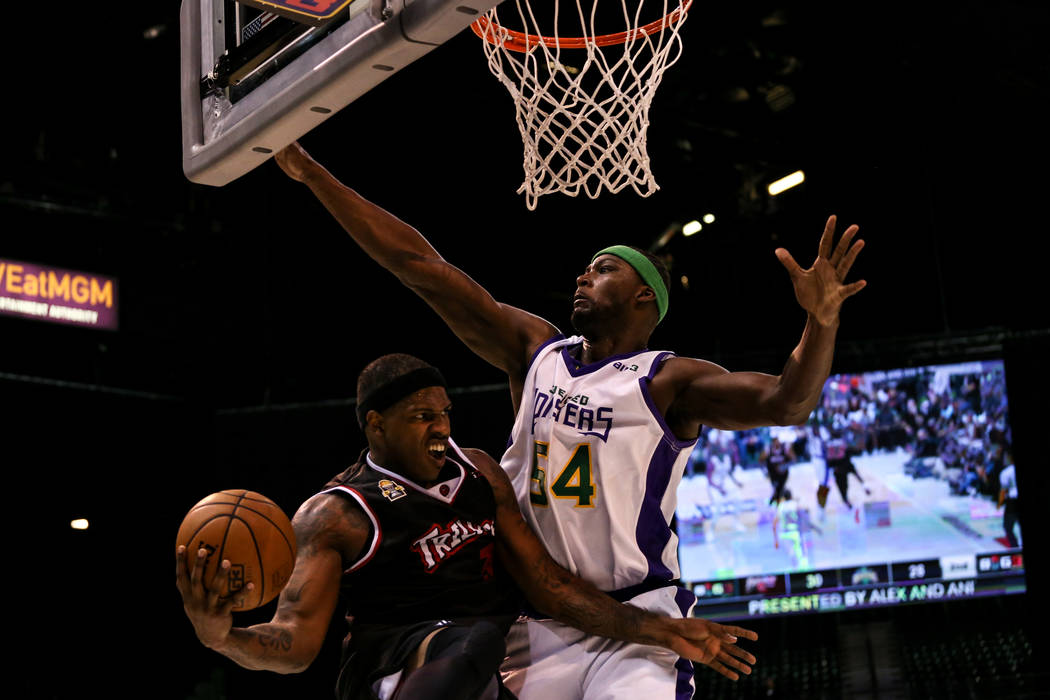 Trilogy's Al Harrington (3) is blocked by 3 Headed Monsters' Kwame Brown (54) during the second half of the Big 3 Championship match at the MGM Grand Garden Arena in Las Vegas on Aug. 26, 2017. Tr ...