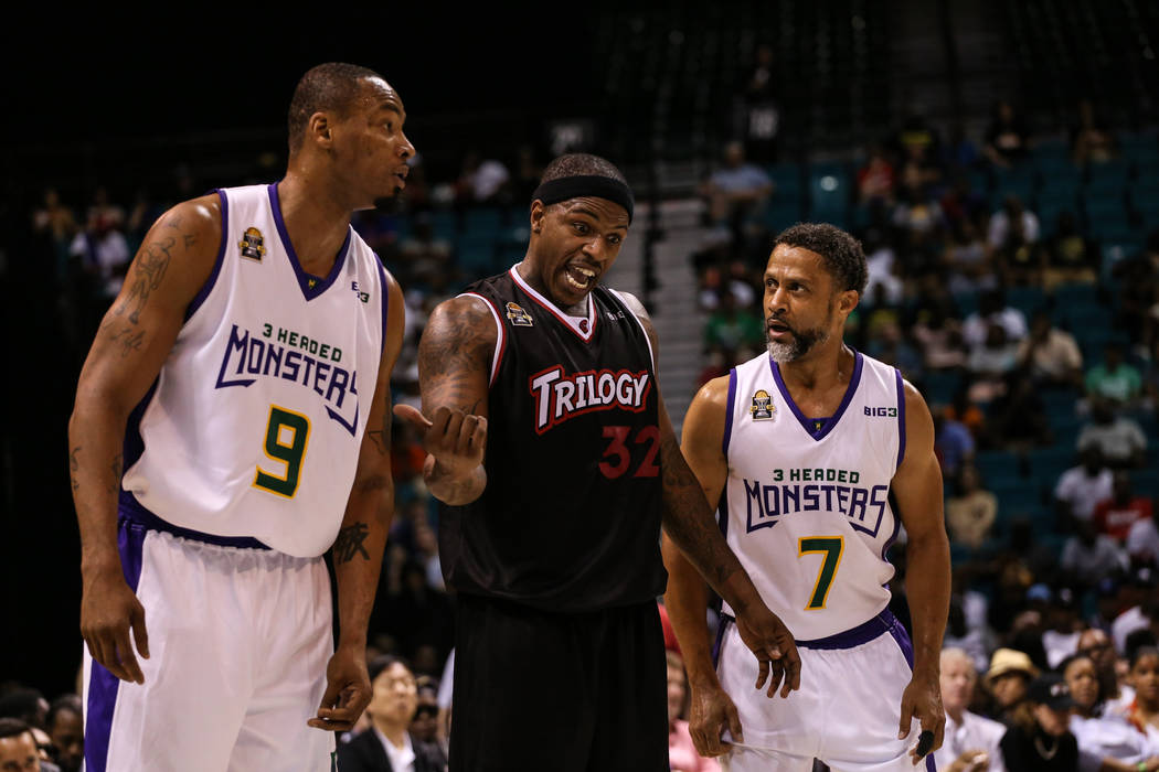Trilogy's Rashad McCants (32) argues with 3 Headed Monsters' Rashad Lewis (9) and Mahmoud Abdul-Rauf (7) after a foul during the second half of the Big 3 Championship match at the MGM Grand Garden ...