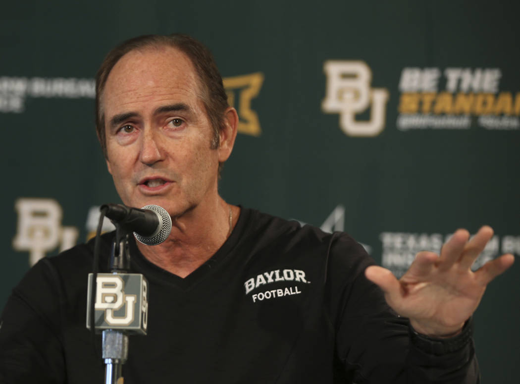 FILE - In this Aug. 25, 2014, file photo, Baylor head football coach Art Briles talks with the media during a press conference in Waco, Texas. The Canadian Football League and Hamilton Tiger-Cats  ...