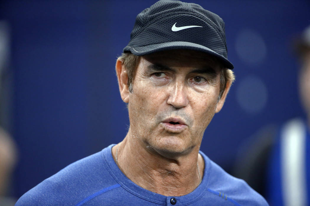 FILE - In this Sept. 25, 2016, file photo, former Baylor football coach Art Briles watches the Dallas Cowboys and the Chicago Bears warm up for an NFL football game in Arlington, Texas. The Canadi ...