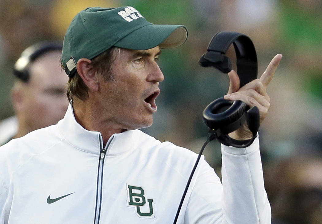 FILE - In this Sept. 12, 2015, file photo, Baylor coach Art Briles yells from the sideline during the first half of an NCAA college football game against Lamar in Waco, Texas. The Canadian Footbal ...