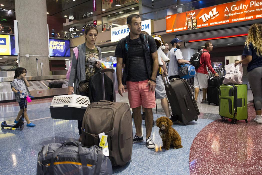 Spirit passengers Azi Sani, left, with her husband Amin of Las Vegas arrive at McCarran International Airport in Las Vegas on Wednesday, Aug. 9, 2017. (Erik Verduzco/Las Vegas Review-Journal) @Eri ...