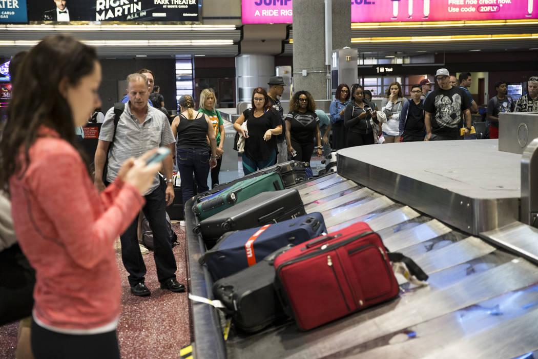 Spirit passengers wait for their luggage at McCarran International Airport in Las Vegas on Wednesday, Aug. 9, 2017. (Erik Verduzco/Las Vegas Review-Journal) @Erik_Verduzco