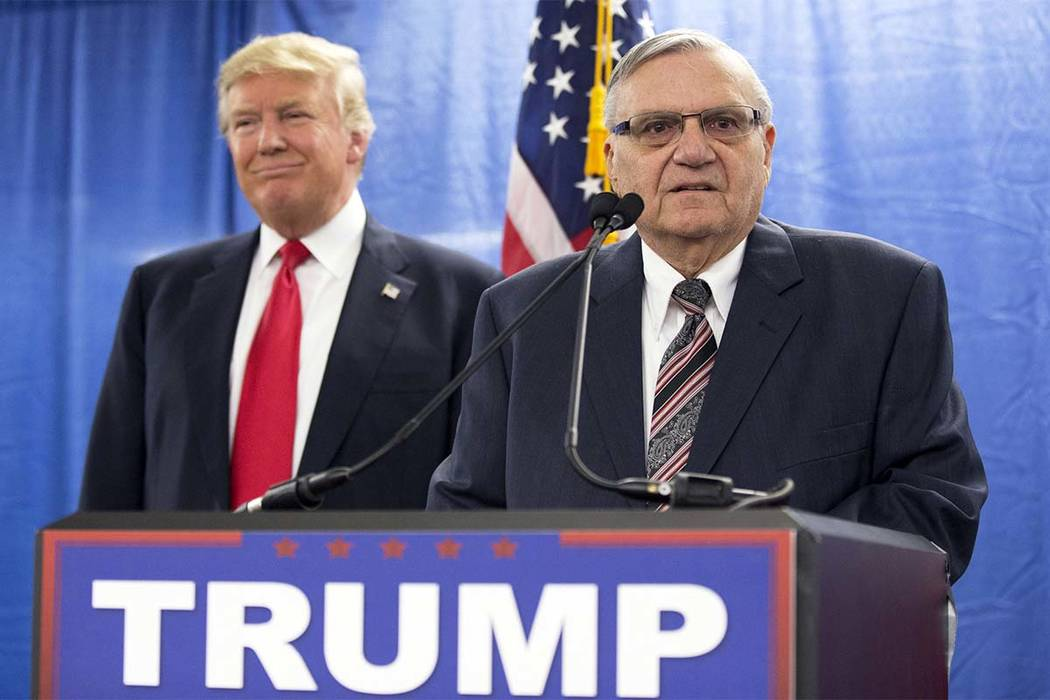 In this Jan. 26, 2016 file photo, Republican presidential candidate Donald Trump, left, is joined by Maricopa County, Ariz., Sheriff Joe Arpaio during a new conference in Marshalltown, Iowa. Trump ...