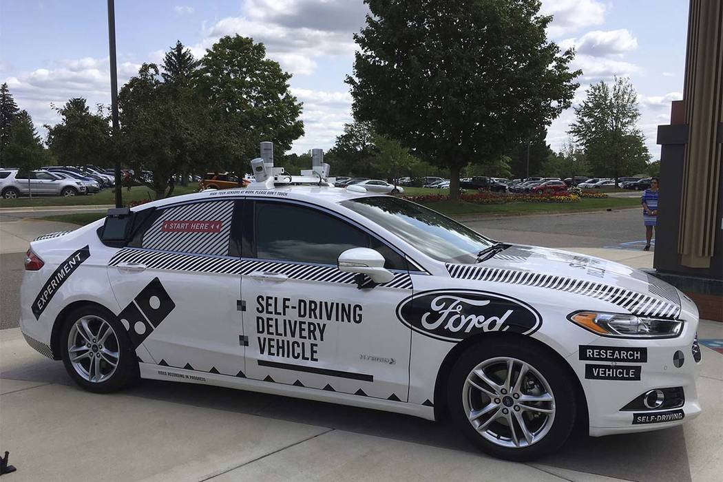 Ford Motor and Domino's Pizza are teaming up to test how consumers react if a driverless car delivers their pizzas. The car, which can drive itself but will have a backup driver, lets customers  ...